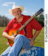 Singing Cowboy - Handsome mature singing cowboy on the farm...