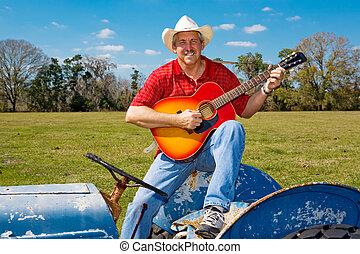 Singing Cowboy Strums Guitar - Handsome mature cowboy...