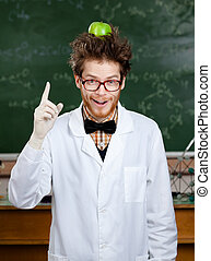 Mad scientist with an apple on his head shows forefinger -...