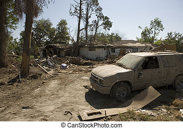 Ninth Ward Home with SUV - Heavily damaged homes in the...