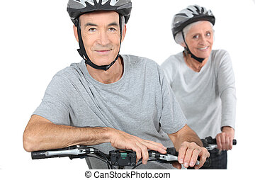 Mature couple biking.