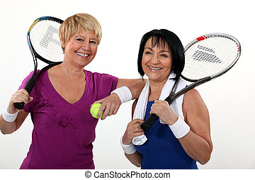 Friends playing tennis