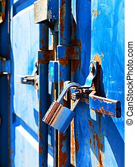Blue rusty container, with silver security lock