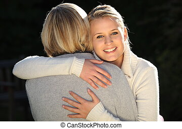 Woman hugging her mother