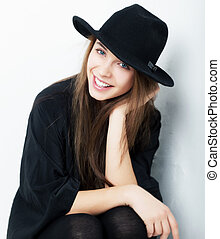 Cheerful beautiful girl in black clothes closeup