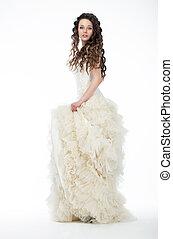 Pretty woman in bridal white dress posing