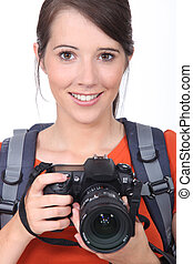 Woman with a digital camera