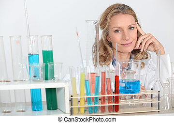 blonde female biologist posing in lab
