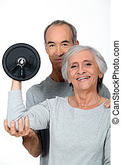Older couple working out with weights