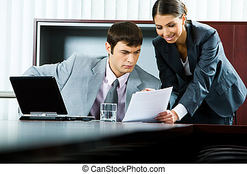 Showing business plan - Photo of pretty smiling secretary...