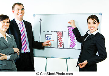 Success - Portrait of business partners standing near...