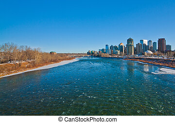 Winter River in Calgary - Icy Bow river with Calgary city in...