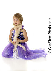 Playing Dress-Up - A pretty young girl playing dress-up in a...
