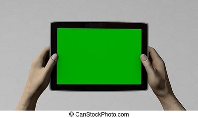 Tablet pc gaming, alpha matte, green screen included.