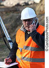 Senior surveyor on construction site