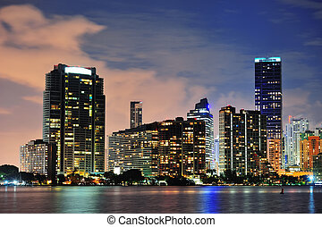 Miami urban architecture closeup over sea at night