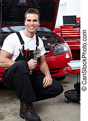 Auto mechanic with a wrench. Car repair service.