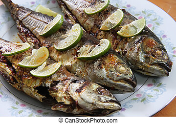 Grilled fish - Grilled whole fish with lemons on plate