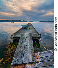 Rickety Island Dock with Mountains and Tankers in Distance -...