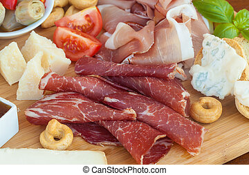 Italian food on chopping board