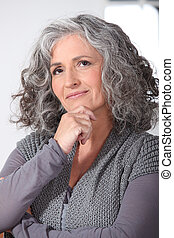 Pensive middle-aged woman