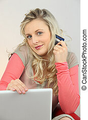 young woman shopping on-line