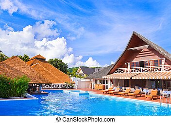 Pool at tropical island - vacation background