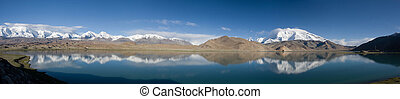 Karakul Lake, China - The Mutzagh Ata mountain and...