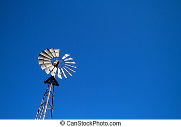 Windmill with blue sky - Farming windmill shot against blue...