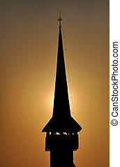 Silhouette of a church tower in the