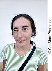 Pretty woman making grimace - Pretty woman cock one' s eye...