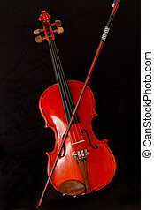 Stringed musical instrument - violin and bow isolated...