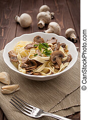 Tagliatelle ai funghi - Noodles with mushroom - Dish of...