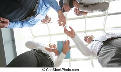 Done deal - The below view of satisfied businessmen shaking...