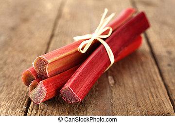 rhubarb stalks on wooden table