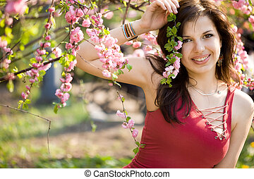 woman in garden with pink flowers