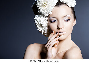 Portrait of the beautiful sweet woman with flowers