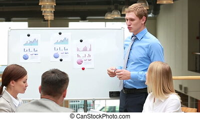 Business vision - Young businessman presenting his vision of...