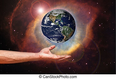 world in hand - Hand holding image of the Earth