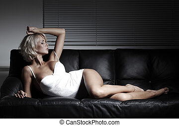 sexy woman on sofa - sexy woman on leather sofa