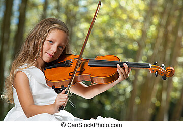 Close up Portrait of young violinist in woods.