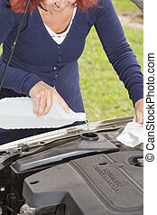 Filling the windshield washer fluid - Vehicle maintenance -...