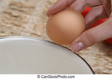 Broken eggs  - Close-up picture of hands broking eggs.