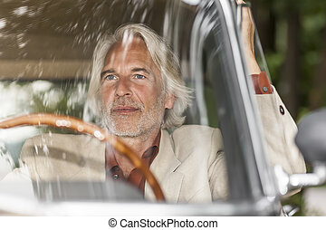 man in his car - An image of a man in his historic car