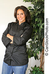 Happy confident female chef - Pretty, confidant young female...