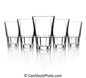 Glass of vodka on white background