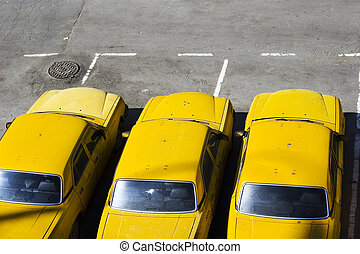 yellow taxi  - The three yellow taxi cars on parking