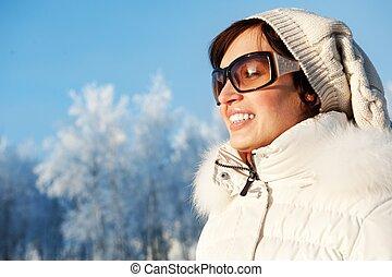 Beautiful young woman enjoying winter day