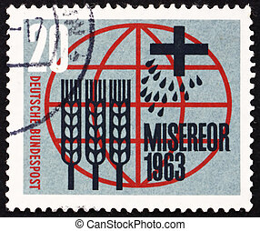 GERMANY - CIRCA 1963: a stamp printed in the Germany shows Globe, Cross, Seeds and Stalks of Wheat, German Catholic Campaign against Hunger and Illness, circa 1963