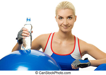Woman with a bottle of water after training